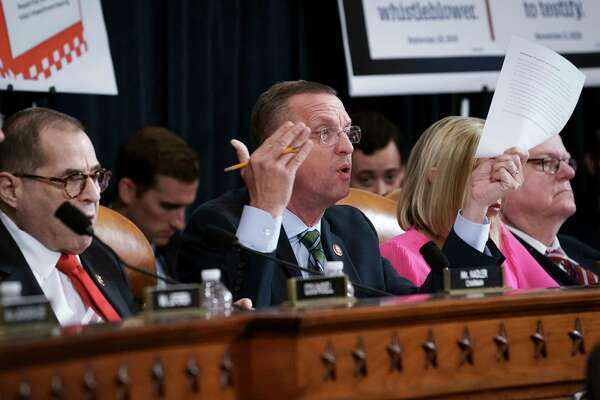 Rep. Doug Collins, R-Ga., the ranking member of the House Judiciary Committee, joined by Chairman Jerrold Nadler, D-N.Y., left, questions investigators during a presentation of the findings in the impeachment inquiry against President Donald Trump, on Capitol Hill in Washington, Monday, Dec. 9, 2019. (AP Photo/J. Scott Applewhite)