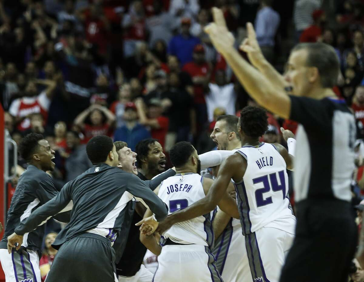 The Sacramento Kings players mob Sacramento Kings forward Nemanja Bjelica (88) after he hit a game-winning 3-pointer as time ran out to beat the Houston Rockets 119-118 in an NBA basketball game at Toyota Center on Monday, Dec. 9, 2019, in Houston.