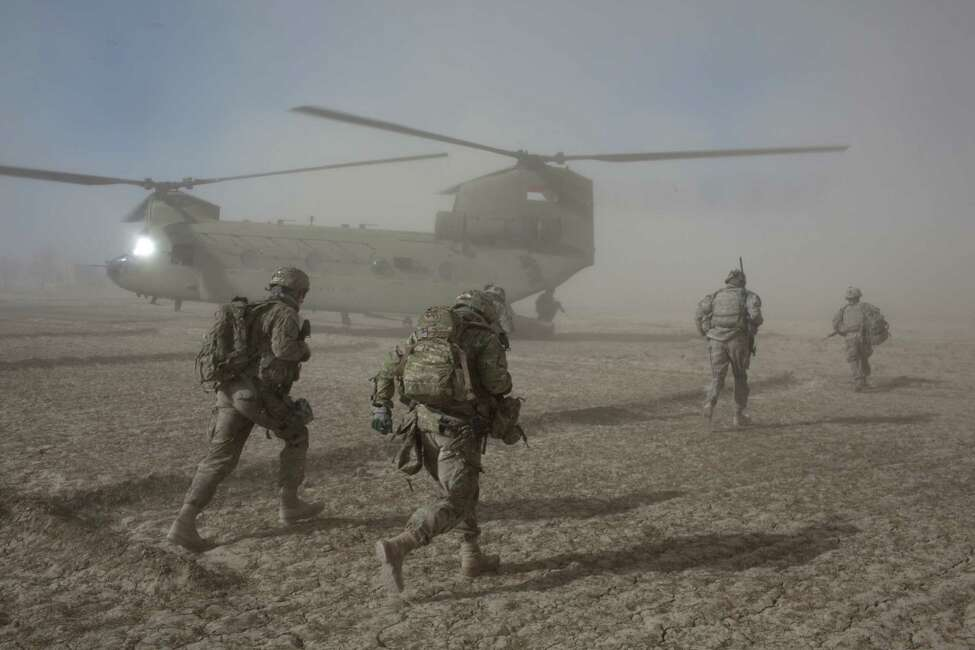 FILE -- American soldiers with the 101st Airborne Division during a morning helicopter raid in the village of Alam Khel, Afghanistan, Jan. 23, 2011. Documents obtained by The Washington Post paint a stark picture of missteps and failures in the American effort to pacify and rebuild Afghanistan. (Tyler Hicks/The New York Times)