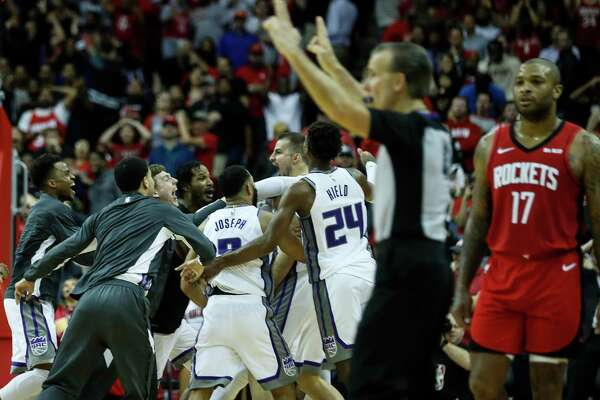 To the dismay of the P.J. Tucker (17), the Kings mob forward Nemanja Bjelica after he hit a game-winning 3-pointer at the buzzer to beat the Rockets.
