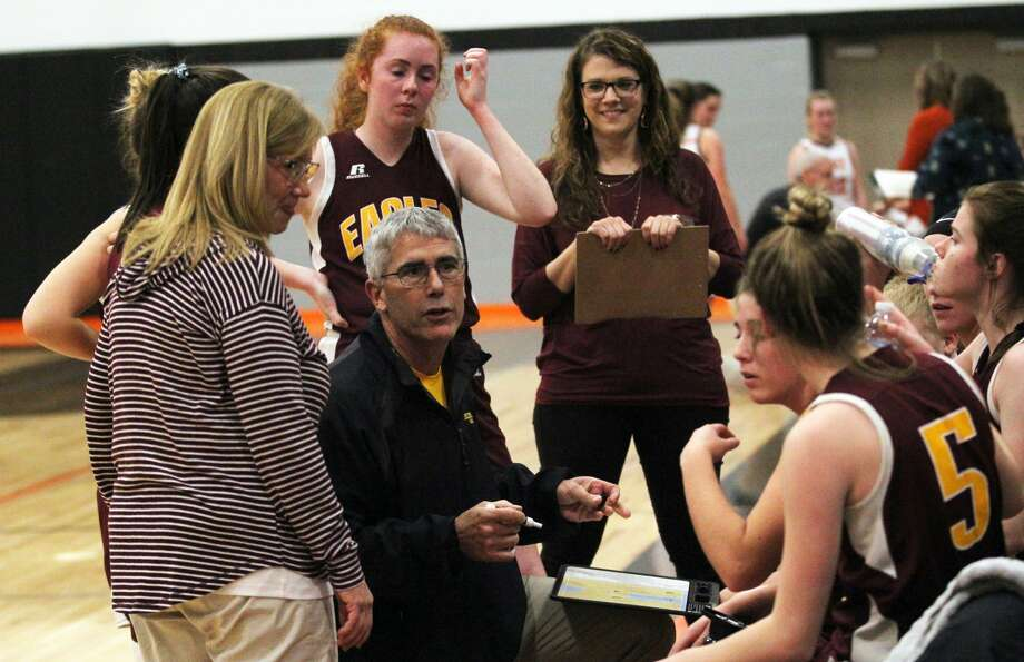 Deckerville girls basketball coach Doug Kirkpatrick talks strategy with his team during a timeout. The Eagles ran past North Huron on Monday night, 71-22. Photo: Tribune File Photo