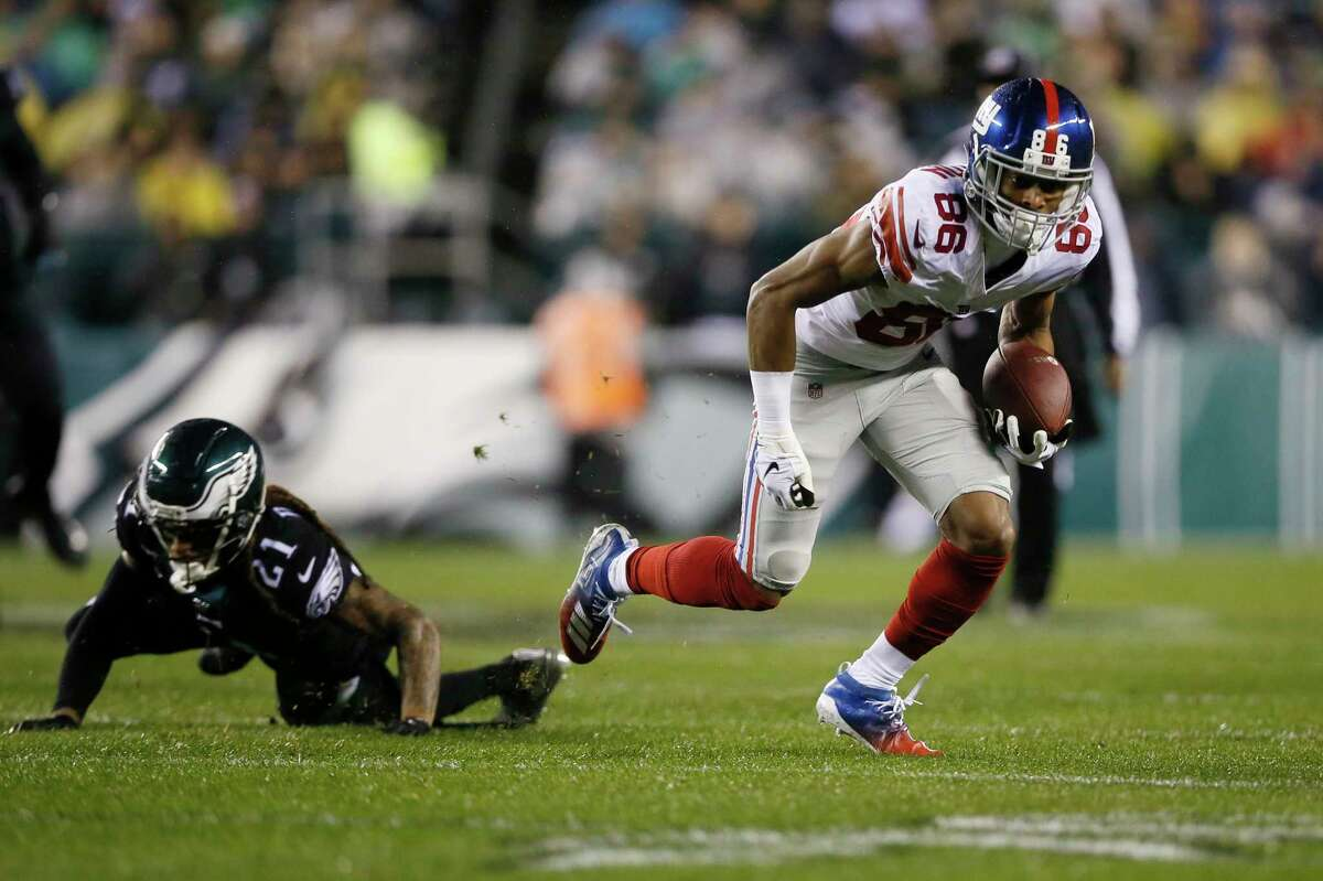 New York Giants' Darius Slayton (86) breaks free from Philadelphia Eagles' Ronald Darby (21) to score a touchdown during the first half of an NFL football game, Monday, Dec. 9, 2019, in Philadelphia. (AP Photo/Michael Perez)