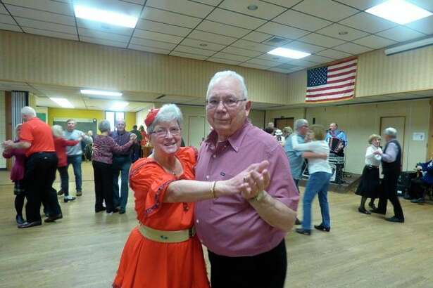 Couples dance the polka at this year's Jingle Bell Ball, sponsored by the Manistee County Council on Aging. (Scott Fraley/News Advocate)