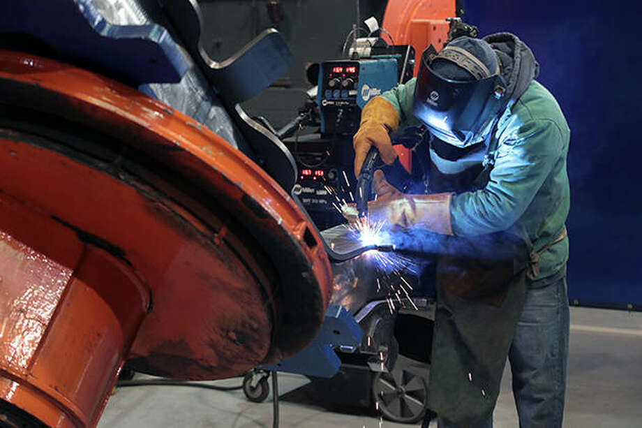 "A worker at LB Steel in Harvey makes a wheel assembly known as a ""bogie"" to be used on the new Amtrak Acela trains being built in partnership with Alstom. The trains will run at speeds up to 160 mph, carrying passengers along Amtrak's Northeast Corridor from Boston to Washington, D.C., beginning in 2021. Photo: Scott Olson 