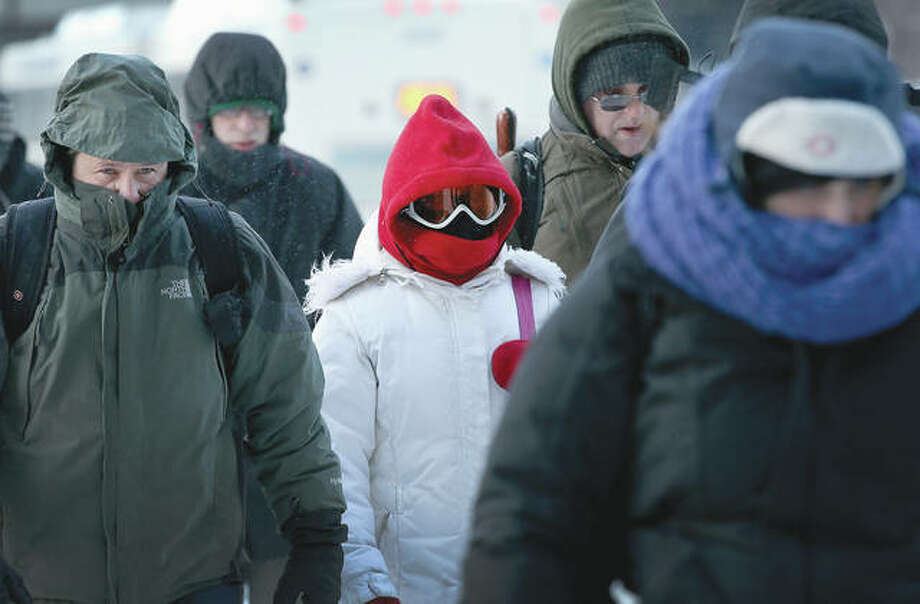 Commuters make a sub-zero trek to work last winter as the temperature dipped to minus 16 degrees on the heels of a polar vortex that swept into the Midwest. Photo: Scott Olson | Getty Images
