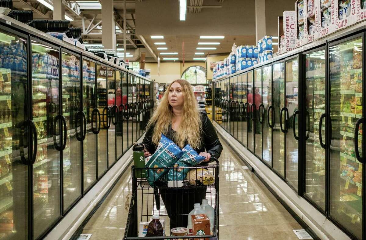 Instacart shopper Vanessa Bain shops for a customer at a Safeway in Menlo Park, California, on Nov. 14, 2019.