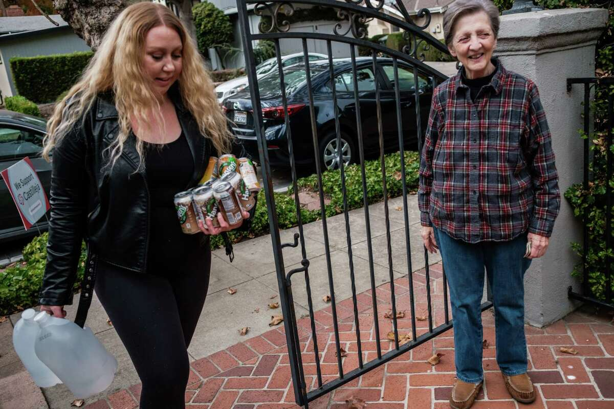 Instacart shopper Vanessa Bain delivers groceries to a customer in Palo Alto, California, on Nov. 14, 2019.