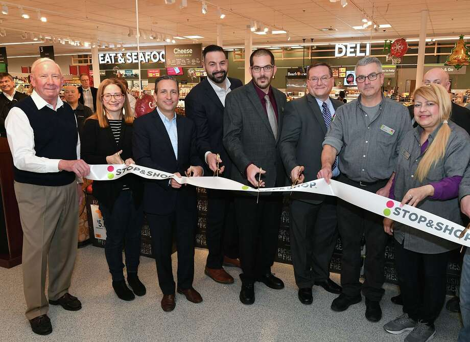 Darien Board of Selectman Kip Koons, left, and Sarah Neumann, Connecticut State Senator Bob Duff, Rudy DiPietro, SVP of Operations for Stop & Shop, Darien Stop & Shop Store Manager Chris Kemp, Stop & Shop District Director Fred Maturo, Darien Store Deli Manager Brian Duff, and Darien Store General Merchandise Lead Claudia Monsalve cut the ribbon reopening the newly remodeled Stop & Shop in Darien. Photo: Marc Levine