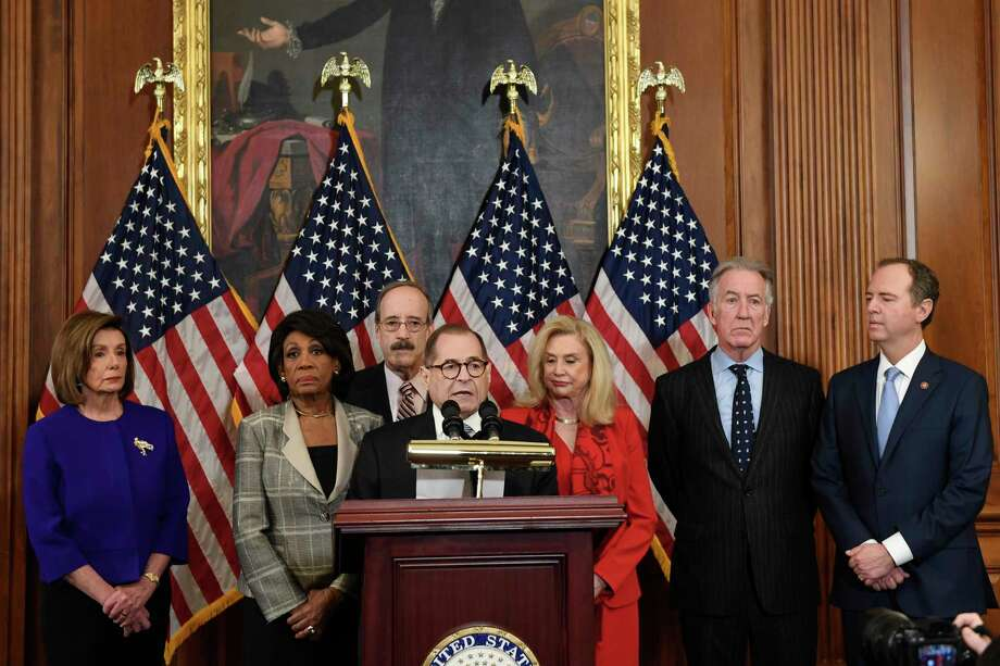 From left House Speaker Nancy Pelosi, Chairwoman of the House Financial Services Committee Maxine Waters, D-Calif., Chairman of the House Foreign Affairs Committee Eliot Engel, D-N.Y., House Judiciary Committee Chairman Jerrold Nadler, D-N.Y., Chairwoman of the House Committee on Oversight and Reform Carolyn Maloney, D-N.Y., House Ways and Means Chairman Richard Neal and Chairman of the House Permanent Select Committee on Intelligence Adam Schiff, D-Calif., unveil articles of impeachment against President Donald Trump, during a news conference on Capitol Hill in Washington, Tuesday, Dec. 10, 2019. Photo: Susan Walsh, AP / Copyright 2019 The Associated Press. All rights reserved.