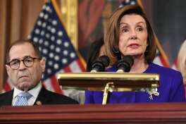 House Speaker Nancy Pelosi next to House Judiciary Chairman Jerry Nadler, Democrat of New York, announces articles of impeachment for US President Donald Trump during a press conference at the US Capitol in Washington, DC, December 10, 2019. - Democrats unveiled two impeachment charges against US President Donald Trump Tuesday, accusing him of abuse of power and obstruction in pressuring Ukraine to help him attack his 2020 election rivals.