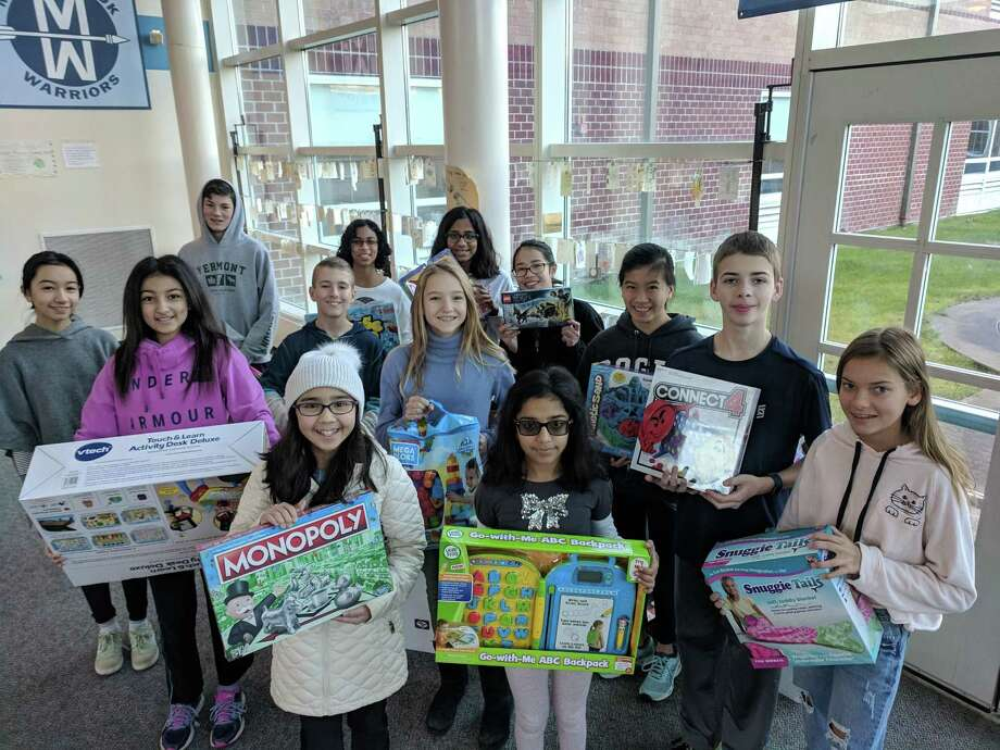 Each year students at Middlebrook School collect donations for the Toys for Tots program. Above, are some of the students who worked on the collection last year. This year's collection runs through Dec. 13. Photo: Contributed Photo / Middlebrook School / Wilton Bulletin Contributed