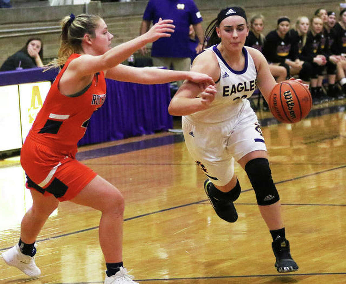 CM's Anna Hall (right), shown driving on a Rochester defender during the Taylorville Tourney on Nov. 30, scored 22 points Monday night to lead the Eagles to a MVC victory over Triad in Troy.