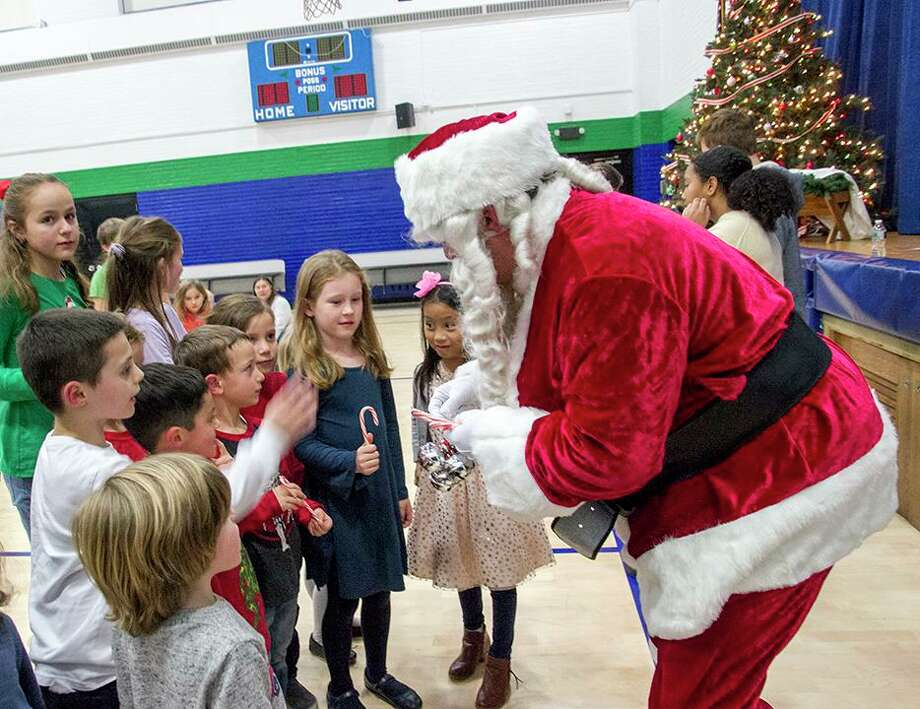 Santa Claus (played by a member of St. George's Knights of Columbus Council 3928) suprised East Shoreline Catholic Academy's students at a Christmas tree lighting event held Dec. 4. Photo: Contributed Photo