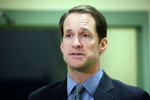 Congressman Jim Himes speaks during a visit to Spooner House, in Shelton, Conn. Jan. 18, 2019. Spooner House started a program through its food pantry to provide meals to local federal workers who have not been receiving paychecks due to the government shutdown.