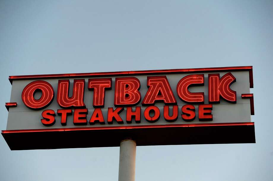 A neon sign at Outback Steakhouse in Beaumont.  Photo taken Tuesday 6/26/18 Ryan Pelham/The Enterprise Photo: Ryan Pelham / The Enterprise / ©2018 The Beaumont Enterprise