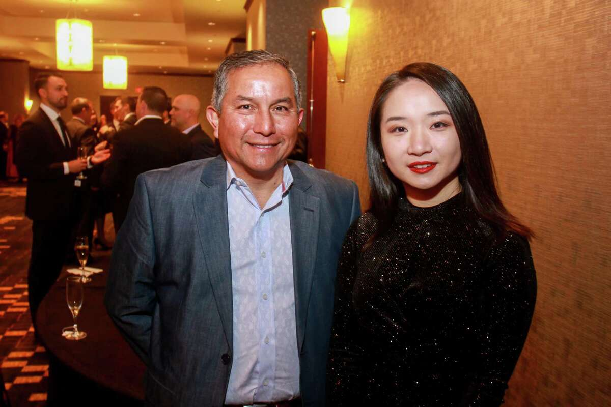 Ralph Castellano and Amanda Hu at Spec's Vintage Virtuoso hosted by Spec's Charitable Foundation, and benefiting the Houston Symphony, at Royal Sonesta Hotel on December 4, 2019.