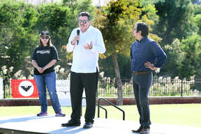 Melissa R. Cigarroa and Carlos E. Flores, right, listen as Mayor Pete Saenz gives the cities position on the proposed border wall at the No Border Wall: A Silent River Sit-In Saturday, December 7, 2019 at the Los Tres Laredos Park by the Rio Grande under the Gateway to the Americas International Bridge.