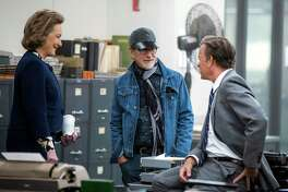 "This image released by 20th Century Fox shows actress Meryl Streep, from left, director Steven Spielberg, and actor Tom Hanks on the set of ""The Post."""