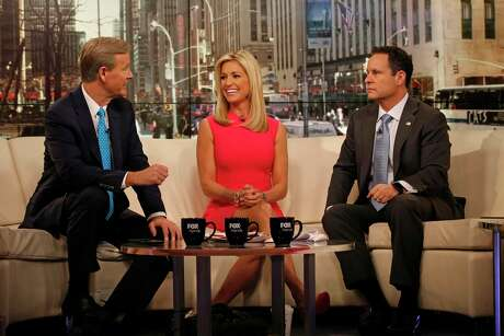 "The cast of ""Fox & Friends,"" including Steve Doocy, left, Ainsley Earhardt, center, and Brian Kilmeade, right, on the set of the Fox News Channel."