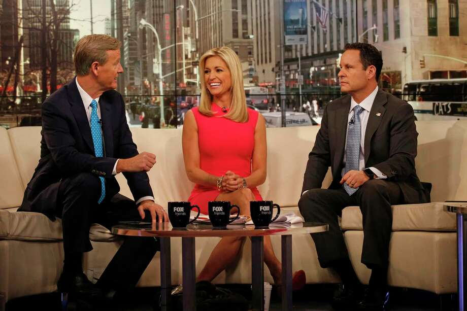 """The cast of """"Fox & Friends,"""" including Steve Doocy, left, Ainsley Earhardt, center, and Brian Kilmeade, right, on the set of the Fox News Channel. Photo: Carolyn Cole, MBR / TNS / Los Angeles Times"""
