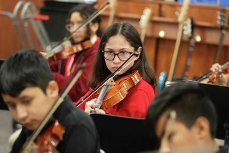 In this October file photo, Pilgrim Academy seventh-grader Avril Garcia practices in the school orchestra. Pilgrim's enrollment increased by 65 students, or 5.7 percent from the previous year, among the largest jumps in Houston ISD in 2019-2020.