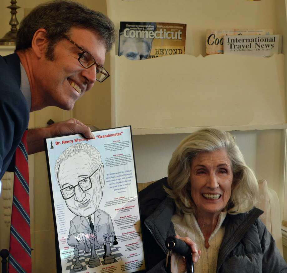 Cartoonist Robert Carley has a photo taken alongside Dr. Henry Kissinger's wife, Nancy. Photo: Robert Carley / Contributed Photo /