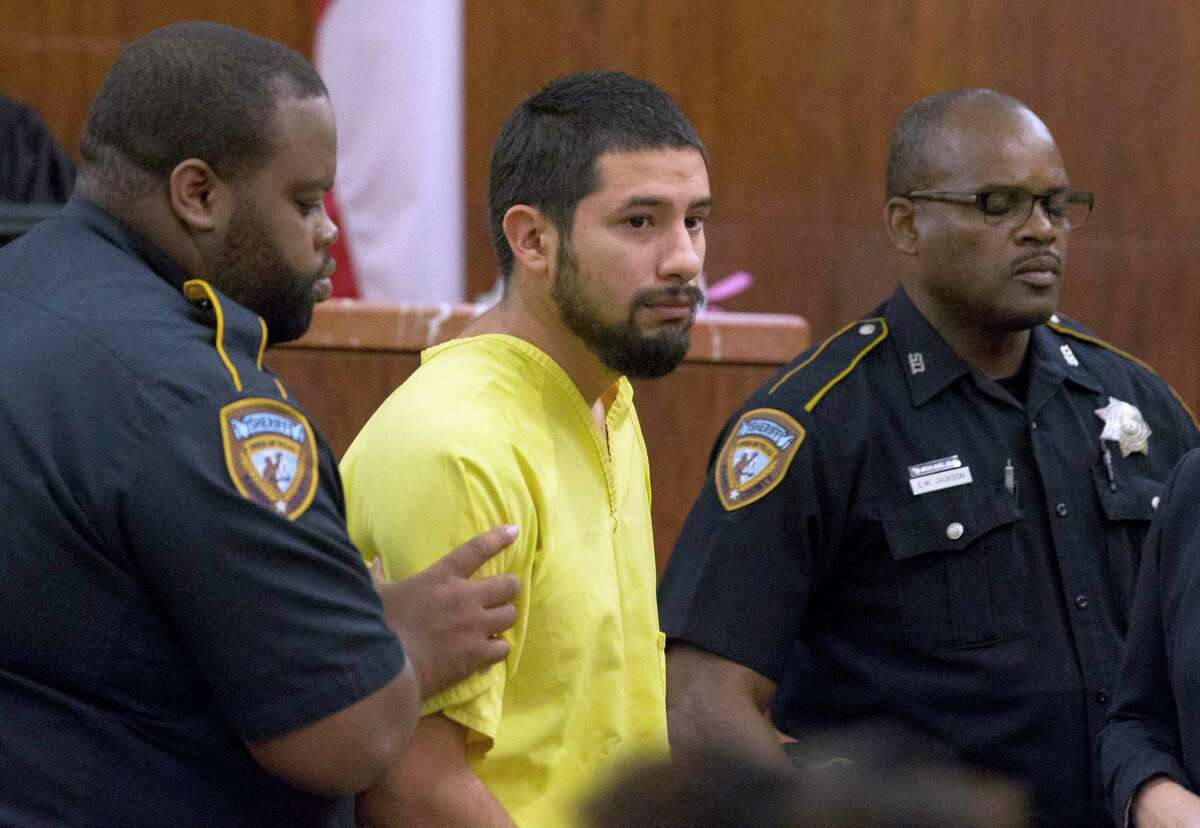 Arturo Solis, 25, is taken away with no bond after he appeared before Judge Danilo Lacayo at the 182nd Judicial District Court at Harris County Criminal Justice Center on Monday, Dec. 9, 2019, in Houston. Solis is accused of shooting and killing Houston Police Department Sgt. Christopher Brewster on Saturday. (Yi-Chin Lee/Houston Chronicle via AP)