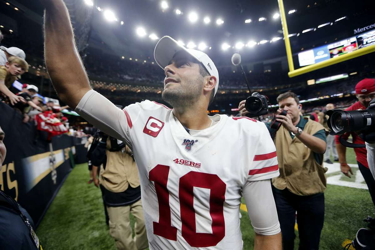 San Francisco 49ers quarterback Jimmy Garoppolo (10) grew fans as he walks off the field after an NFL football game against the New Orleans Saints in New Orleans, Sunday, Dec. 8, 2019. The 49ers won 48-46. (AP Photo/Brett Duke)
