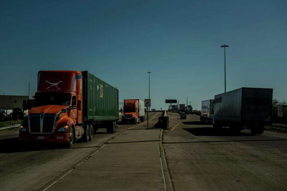 Trucks come and go across the Rio Grande between Laredo, Texas and Nuevo Laredo, Mexico, Jan. 12. That's trade. The U.S. Senate needs to move quickly in its approveal of the USMCA, a needed update to NAFTA. Photo: MERIDITH KOHUT /NYT / NYTNS