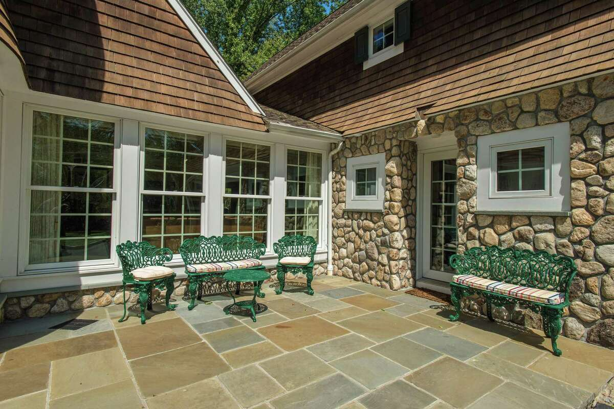 In front of the house there is a flagstone patio on which to sit, relax, and enjoy water views.