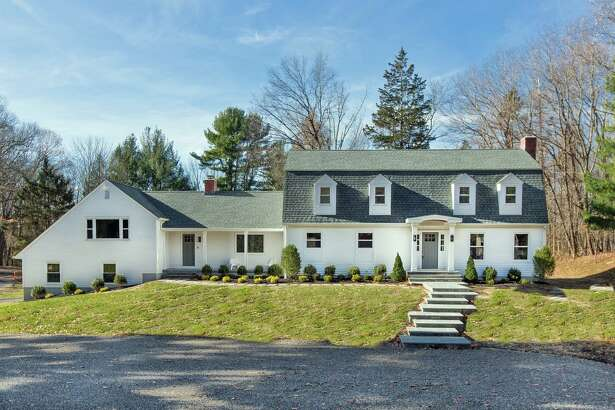 The white colonial house with the distinctive gambrel roof at 23 White Birch Road in Lower Weston was recently and thoroughly renovated.