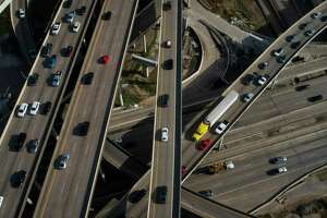 Houston motorists travel on Interstate 69 and the 610 West Loop on Wednesday.