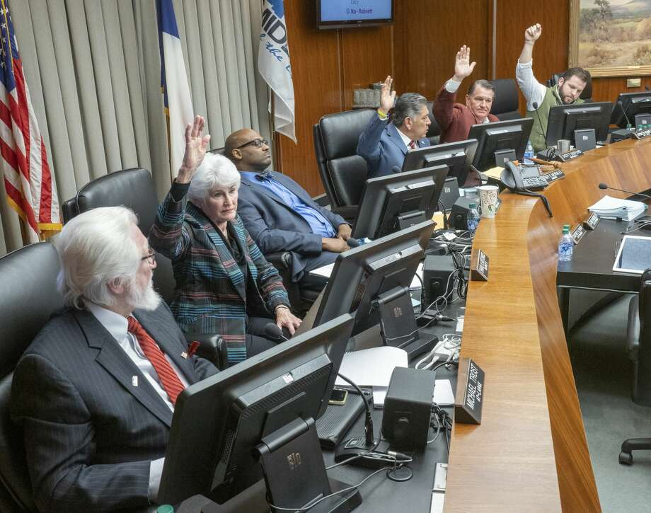 Midland City Council members, Sharla Hotchkiss, Mayor Jerry Morales, Scott Dofford and Spencer Robnett vote to approve the incentives 12/10/19 for a new hotel to be built in downtown Midland, as council members Michael Trost and John B. Love III vote no. Tim Fischer/Reporter-Telegram Photo: Tim Fischer/Midland Reporter-Telegram