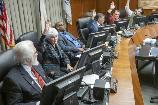 Midland City Council members, Sharla Hotchkiss, Mayor Jerry Morales, Scott Dofford and Spencer Robnett vote to approve the incentives 12/10/19 for a new hotel to be built in downtown Midland, as council members Michael Trost and John B. Love III vote no. Tim Fischer/Reporter-Telegram