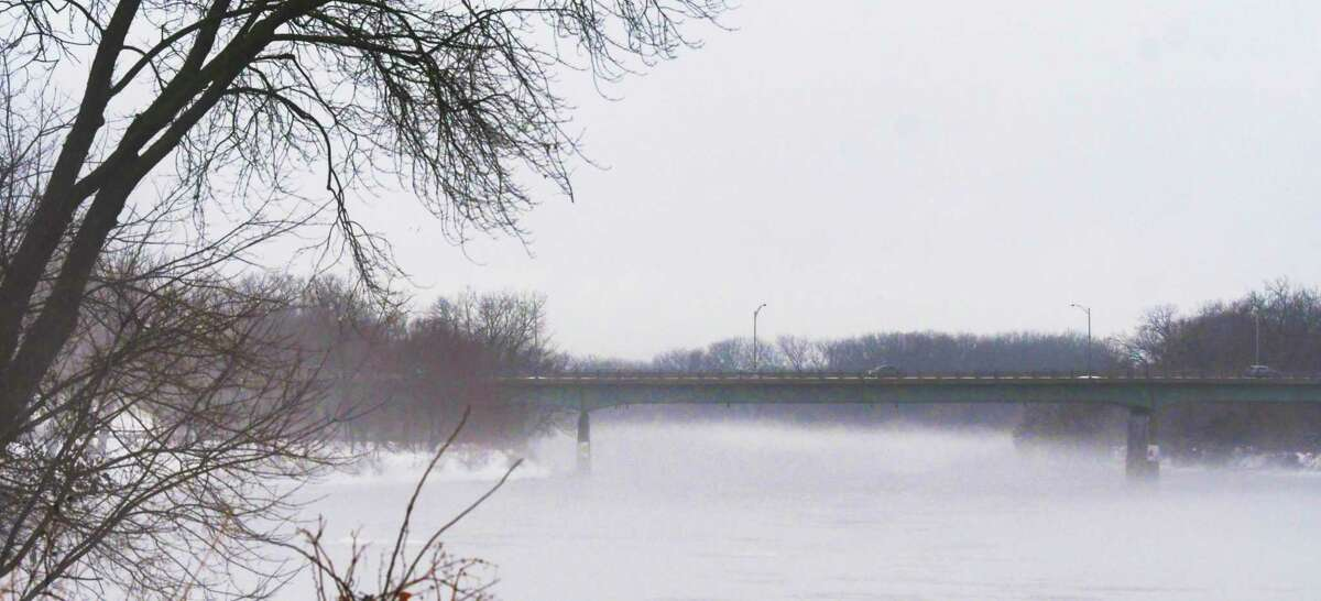 A view of fog on the Mohawk River and the Western Gateway Bridge, seen from Riverside Park on Tuesday, Dec. 10, 2019, in Schenectady, N.Y. (Paul Buckowski/Times Union)