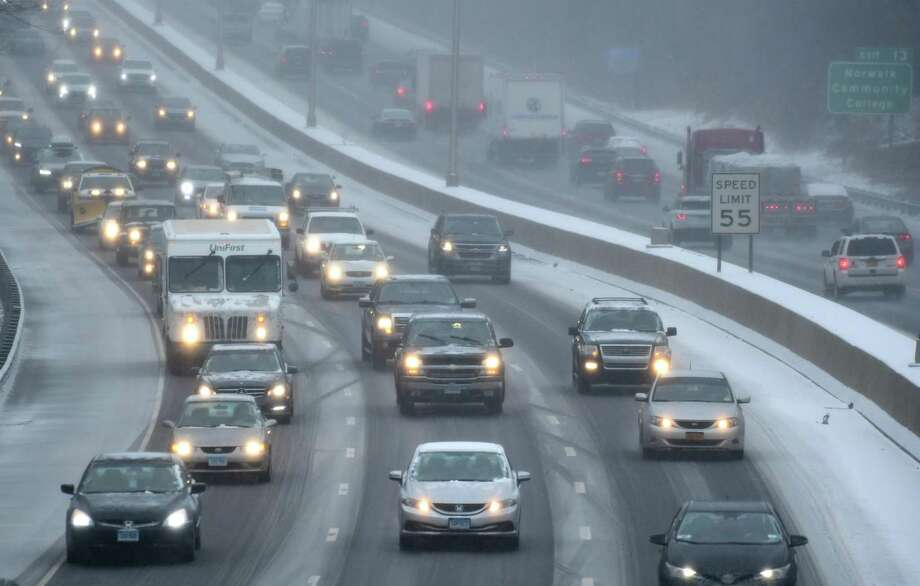 Northbound traffic moves slowly along I-95 due to the inclement weather earlier this year in Norwalk. Photo: Erik Trautmann / Hearst Connecticut Media / Norwalk Hour