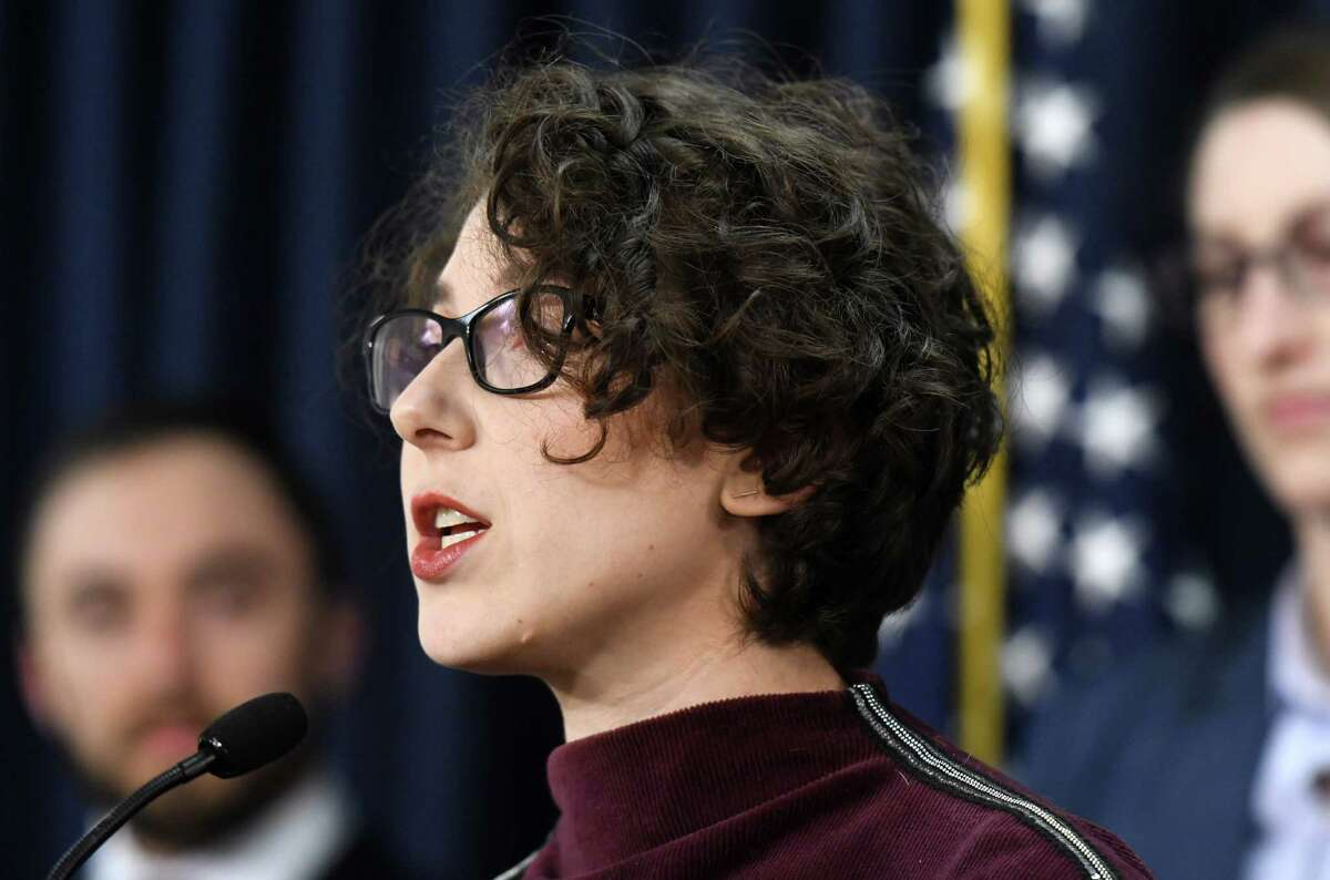 Liz Moran, policy director for the New York Public Interest Research Group (NYPIRG), speaks during a press conference where a coalition of environmental groups pushed for outstanding state environmental bill to be signing by year's end on Tuesday, Dec. 10, 2019, at the Legislative Office Building in Albany, N.Y. (Will Waldron/Times Union)