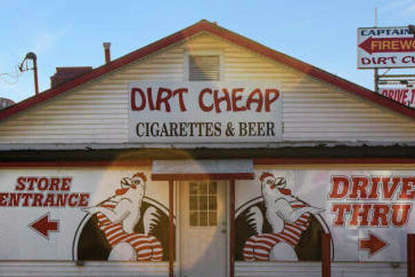 A report released Tuesday states 17 percent of cigarettes smoked in Illinois are bought at businesses outside of the state, such as Dirt Cheap on U.S. 67 in West Alton, Missouri.