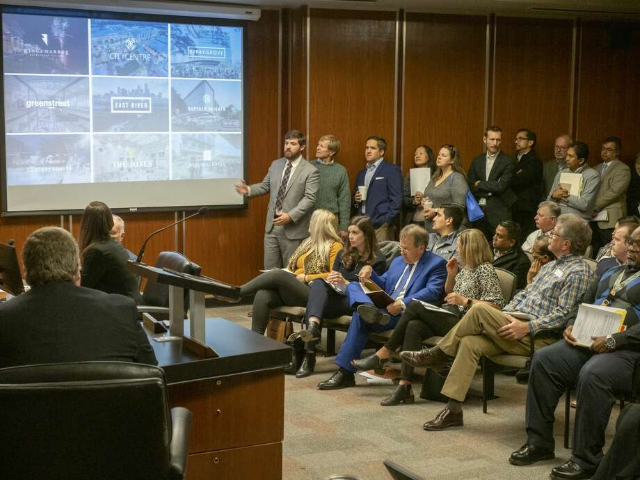 Don Quigley, vice president with Midway Project Team, (by screen) talks about their companies plans for a top tier 4 star hotel in downtown Midland 12/10/19 during the City Council meeting. Tim Fischer/Reporter-Telegram Photo: Tim Fischer/Midland Reporter-Telegram