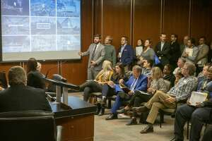 Don Quigley, vice president with Midway Project Team, (by screen) talks about their companies plans for a top tier 4 star hotel in downtown Midland 12/10/19 during the City Council meeting. Tim Fischer/Reporter-Telegram