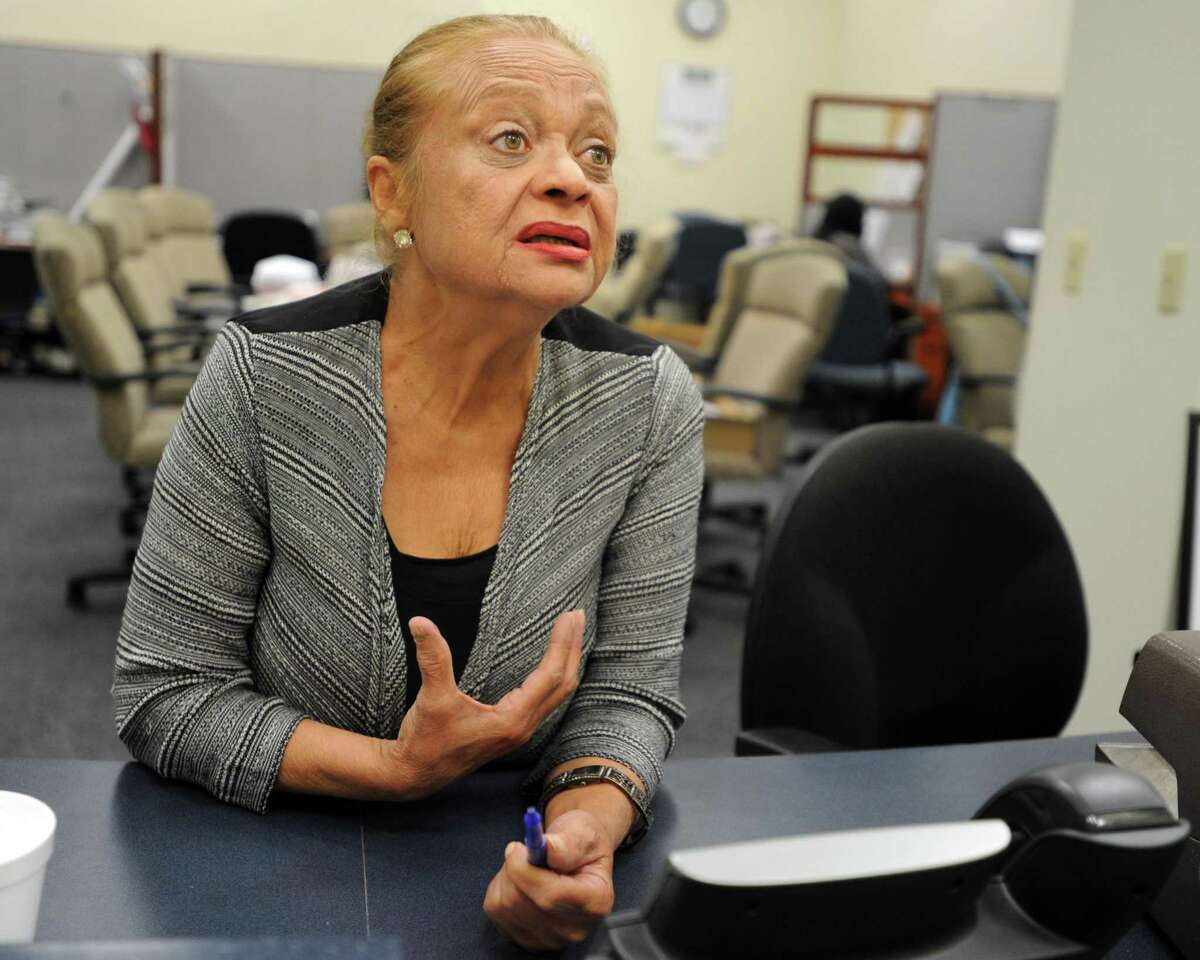 File photo: Santa Ayala discusses a complaint from an East Side resident who claims that he never signed a petition for Joe Ganim's Bridgeport mayoral primary campaign. At the registrars office in the Morton Center, Bridgeport, Conn. Aug. 21, 2015