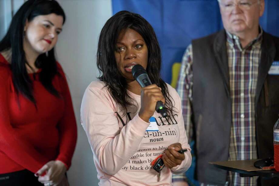 Patrice Harris, one of 2,500 women waitlisted for a free vehicle from God's Garage, bursts into tears as she finds out she was sponsored for a free vehicle by Dean Bass (right) CEO of Spirit of Texas bank, and Rebecca Ramsey (left) from Clear Channel Outdoor. Harris holds her new set of keys while thanking the volunteers and sponsors of God's Garage. Photo: Gustavo Huerta, Houston Chronicle / Staff Photographer / Houston Chronicle