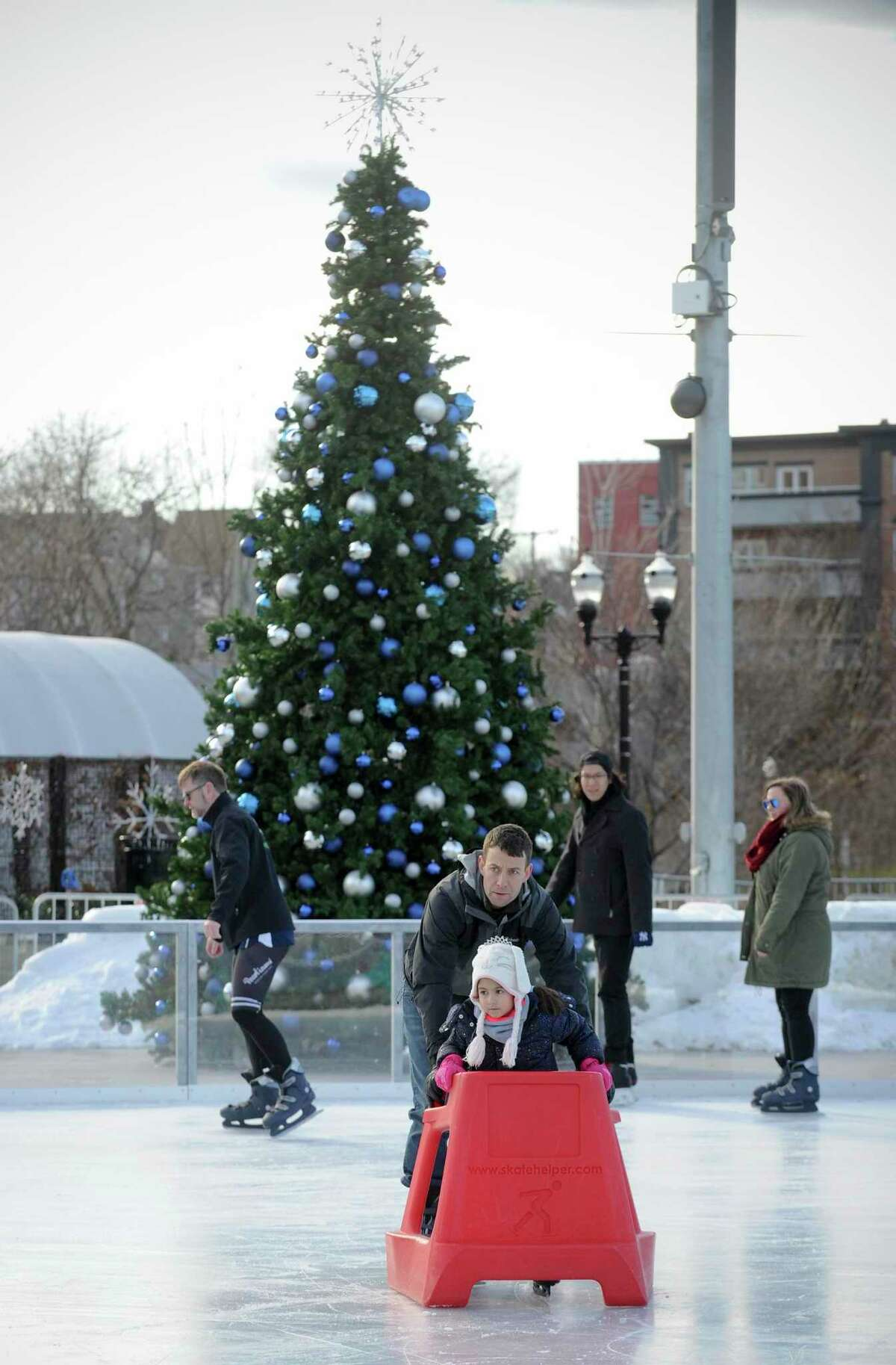 Christian Jacobsen and his daughter Jasmine, 5, take a spin on ice at the Steven and Alexandra Cohen Skating Center at the Mill River Park in Stamford, Conn. on Dec. 7, 2019. The skating center is just one of the many holiday features of the Half Full Brewery and Mill River Park Collaborative Winter Wonderland Market & Beer Garden, which features an indoor area to sit and relax, grab a light lunch from the Snack Box, grab drinks with friends at the Half Full Brewery Beer Garden and much more! The Winter Wonderland is intended to celebrate and unite local residents and professionals through a diverse and expanded slate of programming, which will run from Friday, Dec. 6 through Tuesday, Jan. 1, 2020.