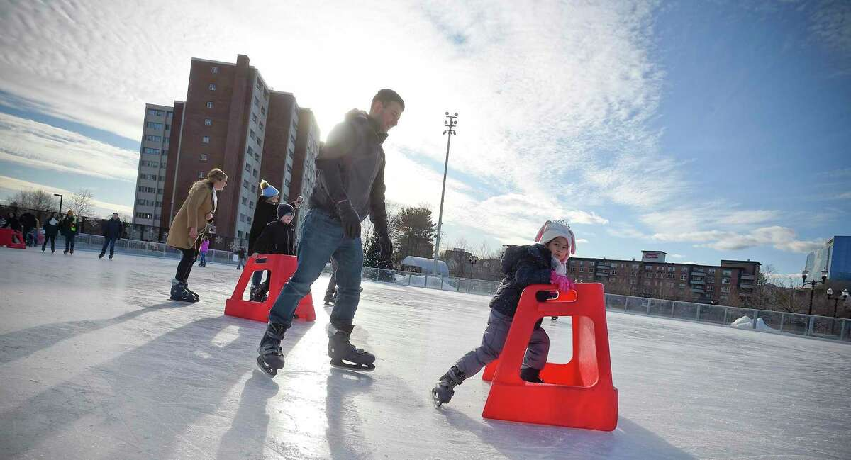 Christian Jacobsen and his daughter Jasmine, 5, take a spin on ice at the Steven and Alexandra Cohen Skating Center at the Mill River Park in Stamford, Conn. on Dec. 7, 2019.
