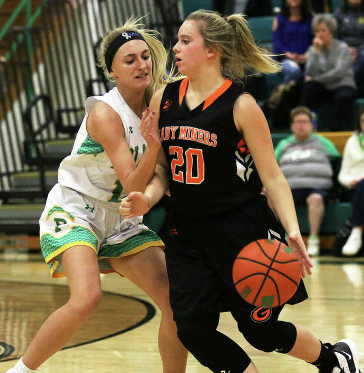 Gillespie's Grace Bertolino (20) handles the ball against defensive pressure from Southwestern's Morgan Durham in the fourth quarter Thursday night in Piasa.