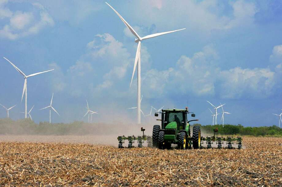 Houston oilfield service company Baker Hughes entered into a 10-year deal to get all the electrcity for its 170 facilities in Texas from renewable sources such as wind and solar. Photo: Jason Hoekema, MBI / Associated Press / Valley Morning Star