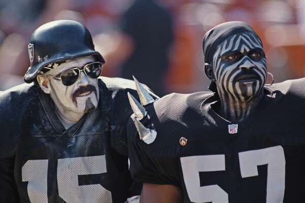 Oakland Raiders fans complete with make up support their team during the American Football Conference West game against the Seattle Seahawks on 8 October 1995 at the Oakland-Alameda County Coliseum, Oakland, United States. The Raiders won the game 34 - 14.