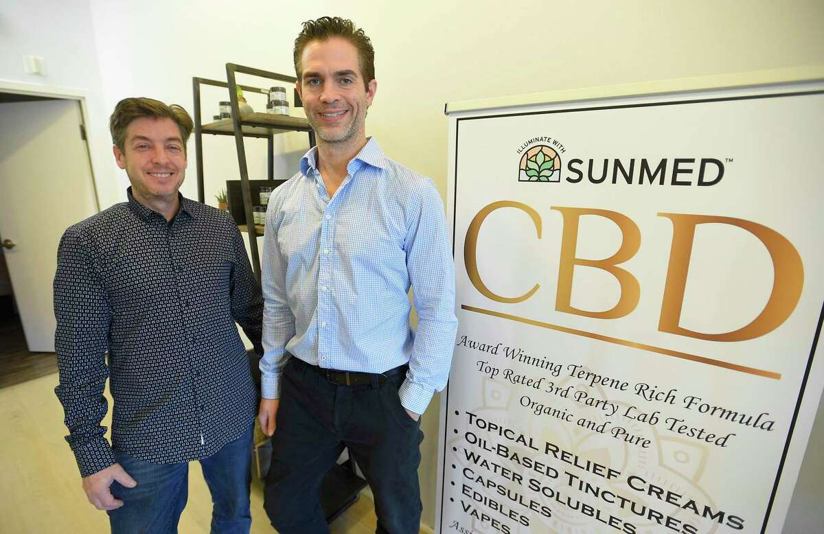 Co-owners Howard Kohlenberg and Harris Grannick are photograph at their newly opened Your CBD store in Greenwich late last month; below, some of their products.