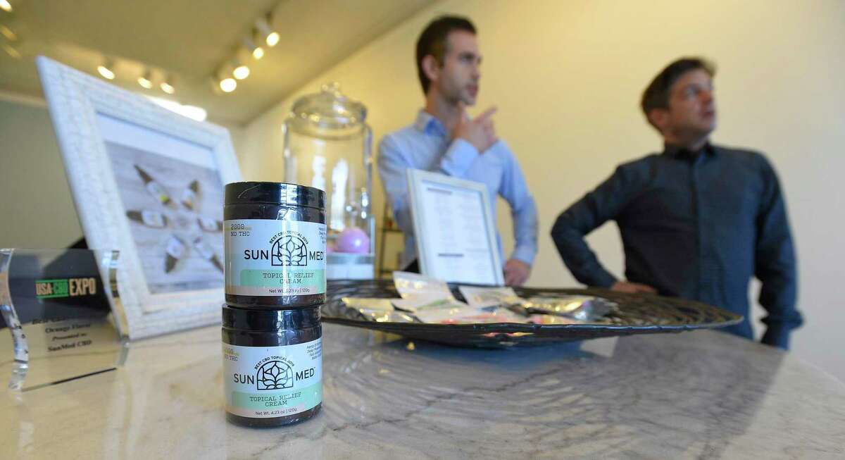 Co-owners Harris Grannick and Howard Kohlenberg are photograph at their newly opened Your CBD store in Greenwich, Conn. on Nov. 29, 2019 with some of the products they sell.