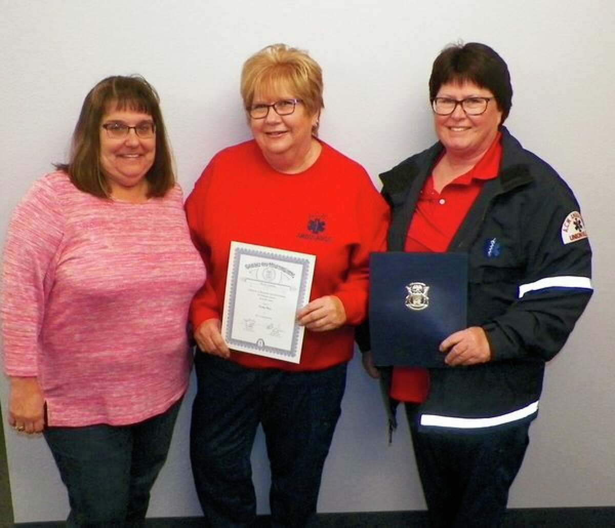 Two ACW Ambulance service members received state recognition for 30 years of service. Showing the certificatesare Wisner Township Clerk Pamela Shook, who is chair of the ACW Ambulance Board, and EMTs Kathy Hare and Alice Vermeersch. (Provided photo)